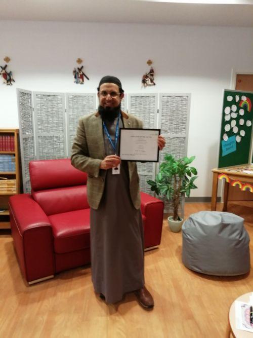 Imam Fazal Hassan with his award